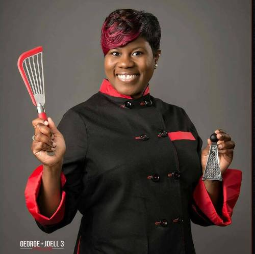 Photo of Chef Judy holding a cooking tool.