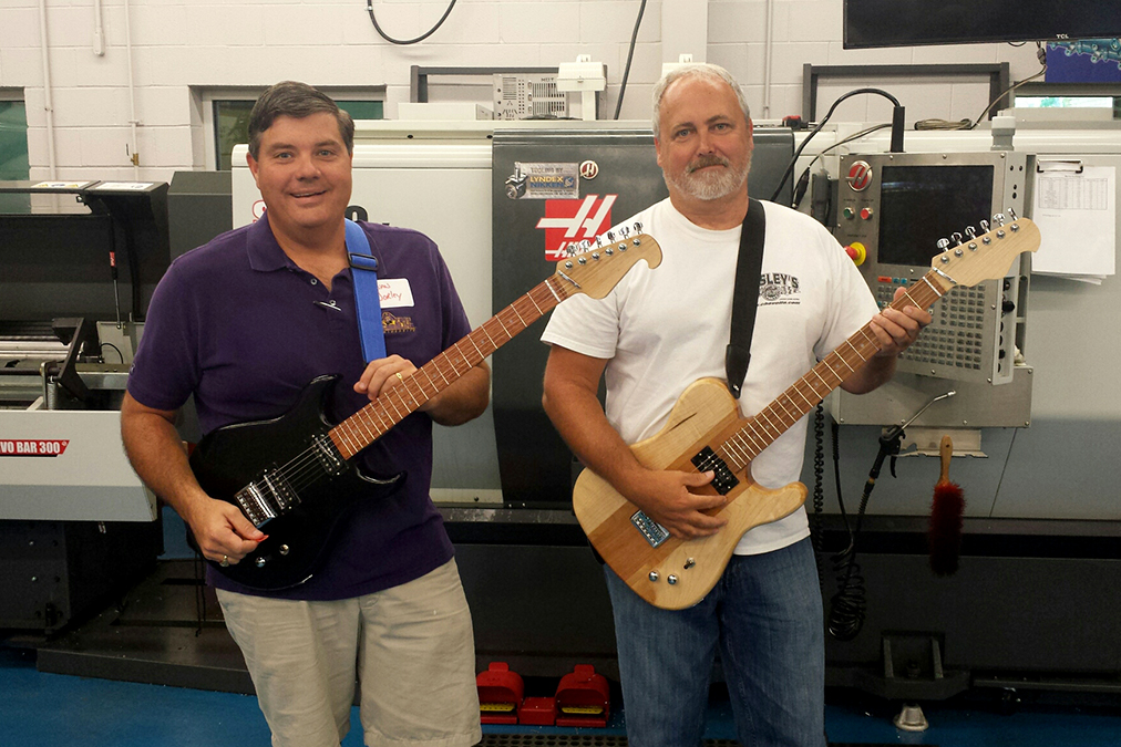 JCC instructors Brian Worley and Dwight Barnes show off their guitars.