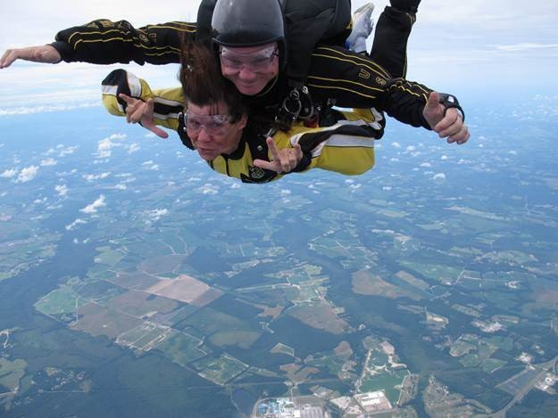 Sign language instructor Kaye Beddard tandem skydives with the Golden Knights.