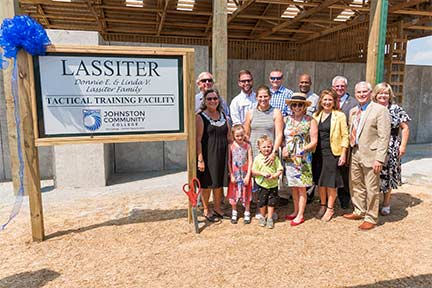 Pictured from left are Donnie and Linda Lassiter and members of their family; Lyn Austin, chair JCC Board of Trustees; Major Shane S. Manuel of the N.C. Highway Patrol; N.C. Rep. Donna White; Johnston County Sheriff Steve Bizzell; Dr. David Johnson, JCC president; and Dr. Twyla Wells, executive director of the JCC Foundation.
